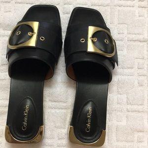 CALVIN KLEIN black slides w/buckle on top size 7